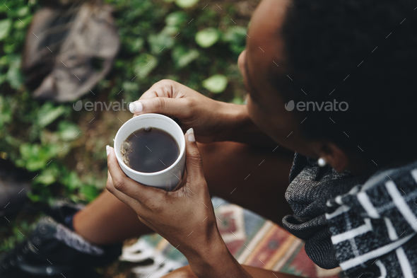 Woman enjoying her morning coffee in nature - Stock Photo - Images