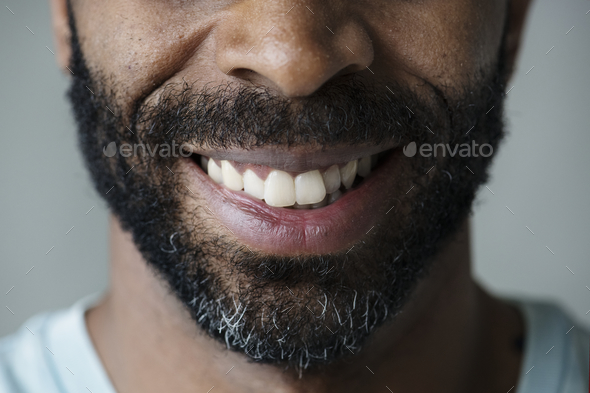Closeup of smiling teeth of a black man - Stock Photo - Images