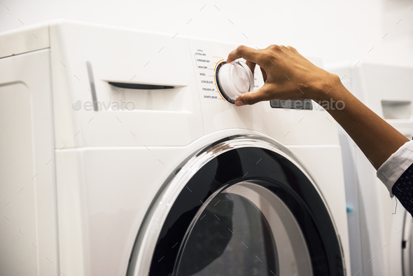 Indian woman doing a laundry - Stock Photo - Images