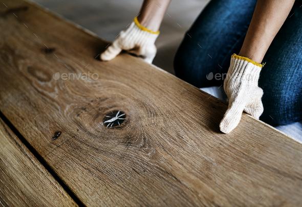 Carpenter man installing wooden floor - Stock Photo - Images