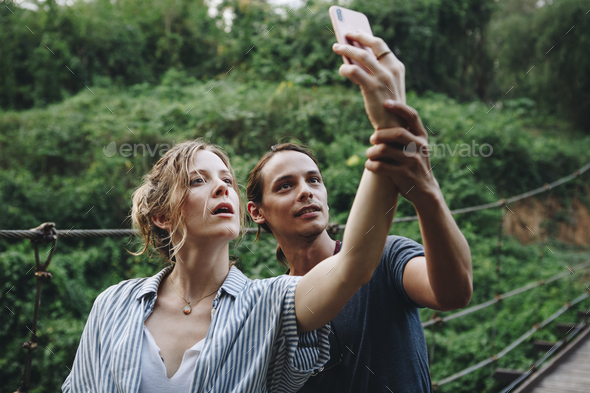 Caucasian woman and man taking a selfie outdoors recreational leisure, freedom and adventure concept - Stock Photo - Images