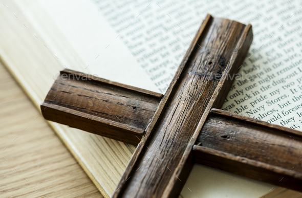 Closeup of wooden cross on bible book religion and belief concept - Stock Photo - Images