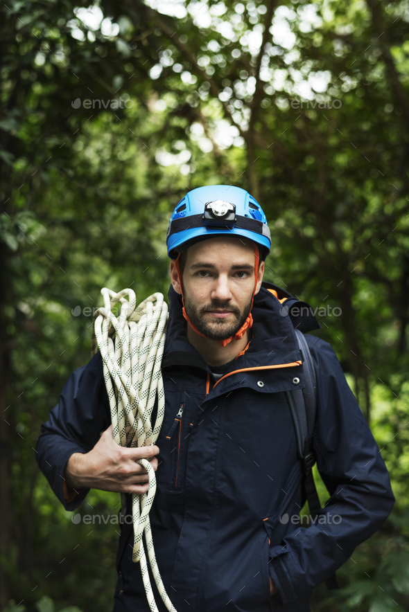 Man with climbing rope - Stock Photo - Images