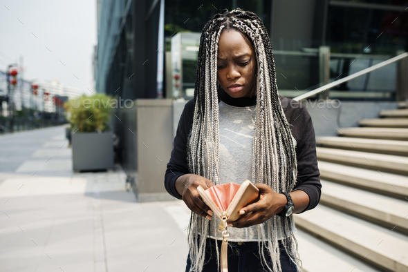 African descent checking her wallet - Stock Photo - Images