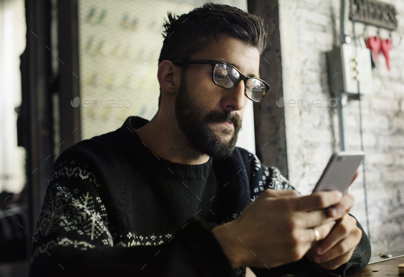 A man using a smartphone - Stock Photo - Images