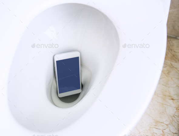 Smartphone fell in the toilet bowl - Stock Photo - Images
