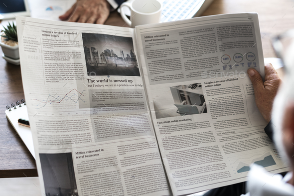 Business people reading newspaper - Stock Photo - Images