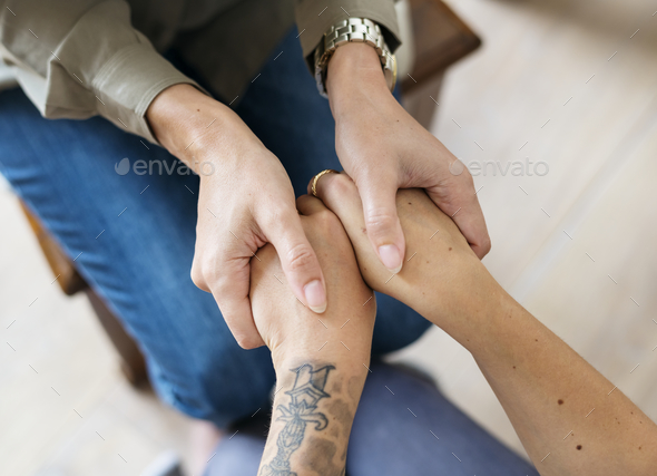 Women holding hands support - Stock Photo - Images