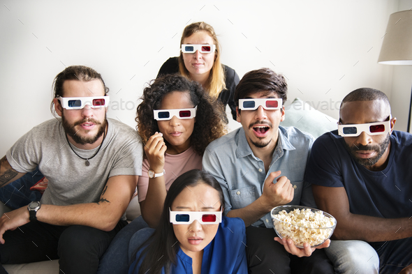 Group of diverse friends watching 3D movie together - Stock Photo - Images