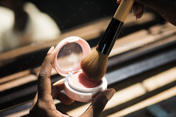 Closeup of woman using blush on - Stock Photo - Images