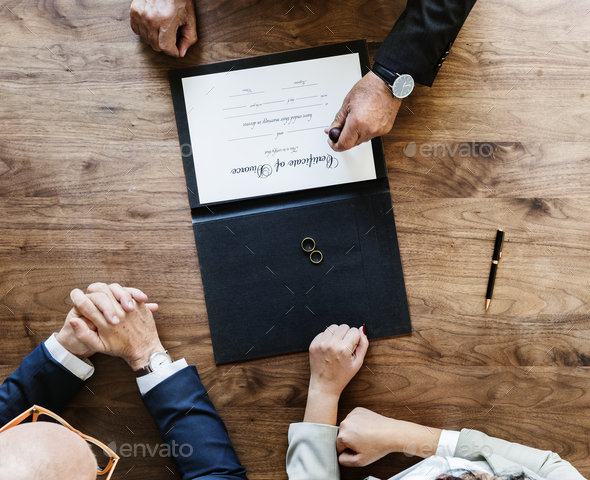 Brekaup marriage couple with divorce certification - Stock Photo - Images