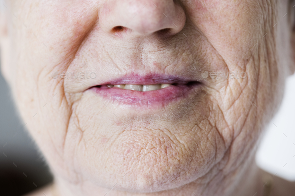 Portrait of white elderly woman closeup on smiling lips - Stock Photo - Images