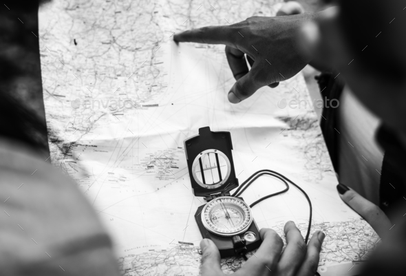 People using compass in black and white - Stock Photo - Images