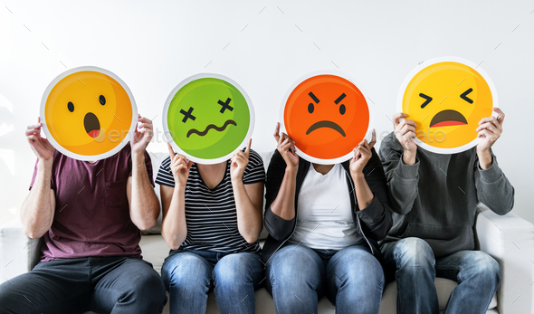 Diverse people holding emoticon - Stock Photo - Images
