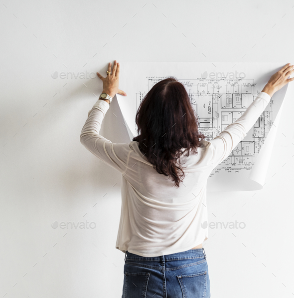 Blueprint showing building plan on white wall - Stock Photo - Images