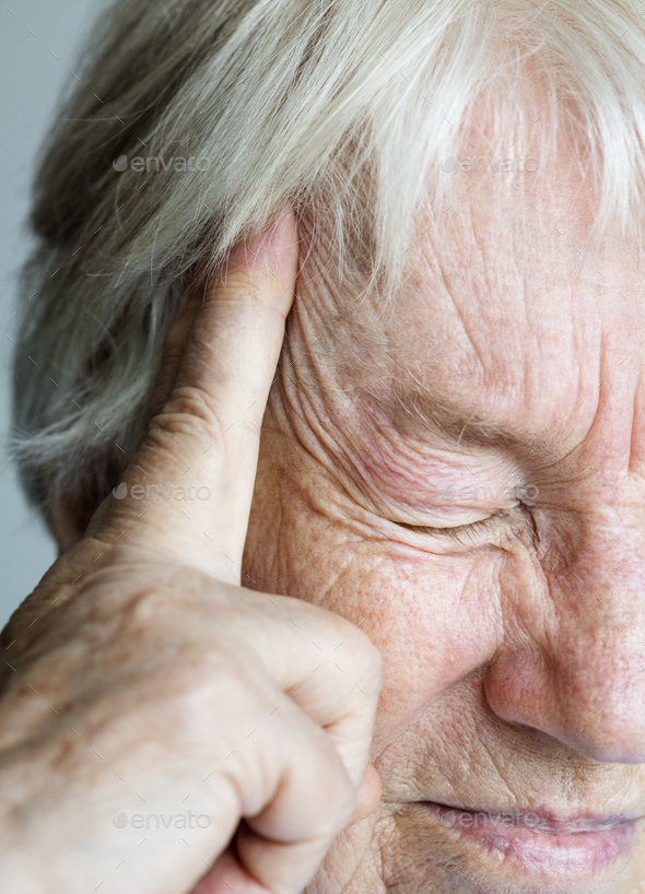 Elderly woman suffering from migraine - Stock Photo - Images