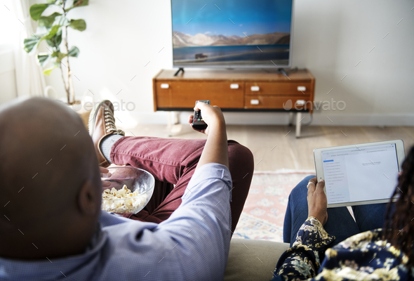 Couple watching TV at home together - Stock Photo - Images