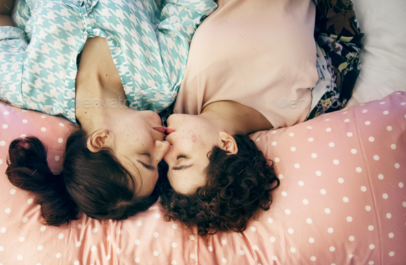 Lesbian couple sleeping on the bed together - Stock Photo - Images