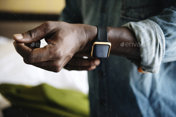 Man wearing a watch - Stock Photo - Images
