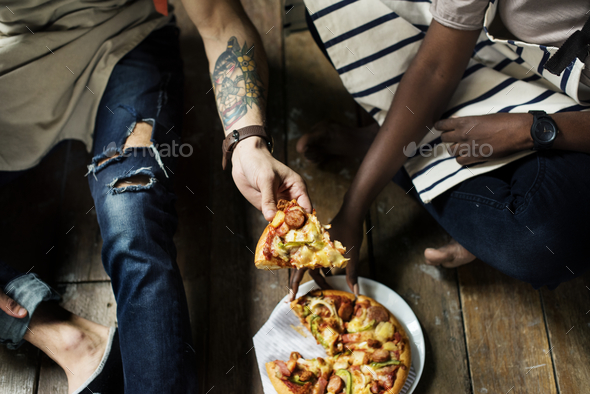 A couple eating pizza together - Stock Photo - Images