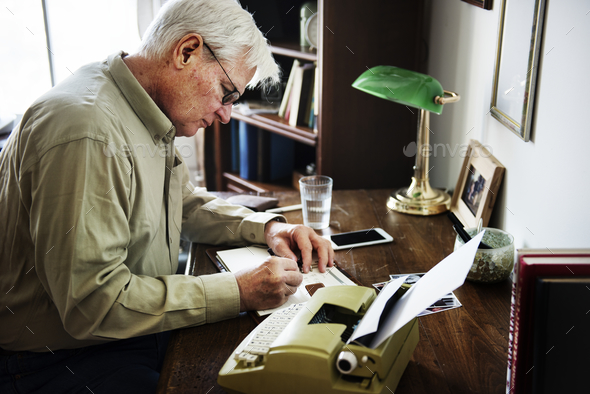 Senior man writing - Stock Photo - Images