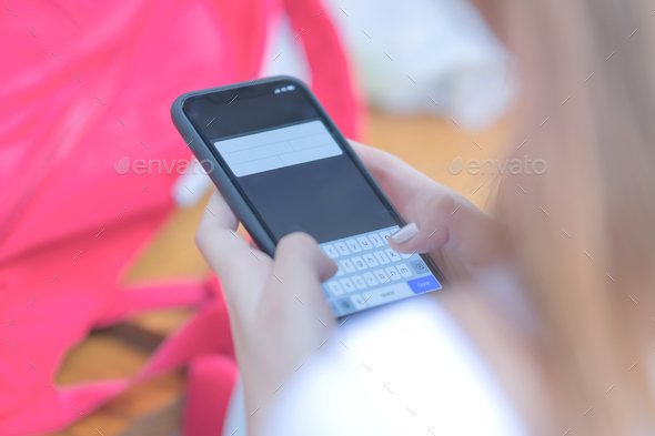 Young girls are using a smart phone. - Stock Photo - Images