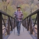 Active Woman Hiking Goes Through a River Bridge In Zion Park USA - VideoHive Item for Sale