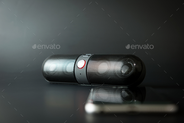 Portable speaker with mobile phone - Stock Photo - Images