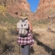 Tourist Hiking In Red Mountains Active Woman Walks In Zion Park - VideoHive Item for Sale