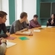 Group of Students and a Teacher Sit at a Table and Talk - VideoHive Item for Sale