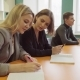 Woman Student Writes in a Notebook and Explains To Her Friend a Lesson - VideoHive Item for Sale