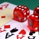 Red Dice on the Game Table with Cards and Chips to Play - VideoHive Item for Sale