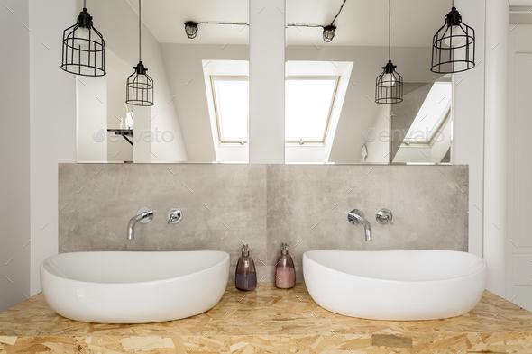 Bright bathroom interior in attic - Stock Photo - Images