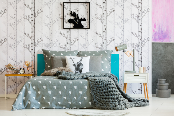 Bright bedroom with forest motif - Stock Photo - Images