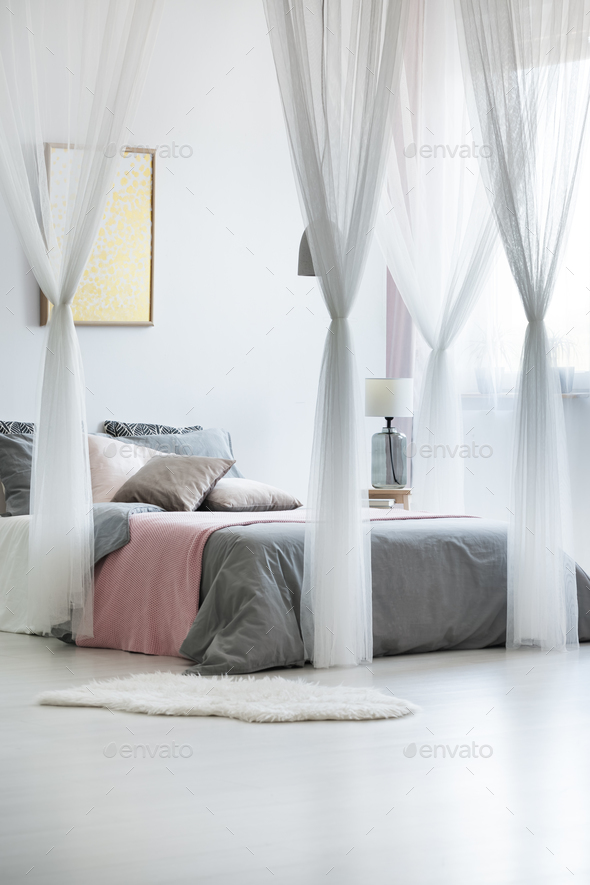 Canopy drapes in calm interior - Stock Photo - Images