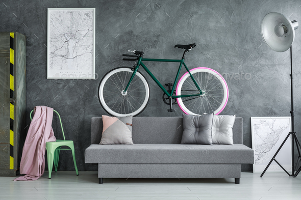 Dark grey studio with bicycle - Stock Photo - Images