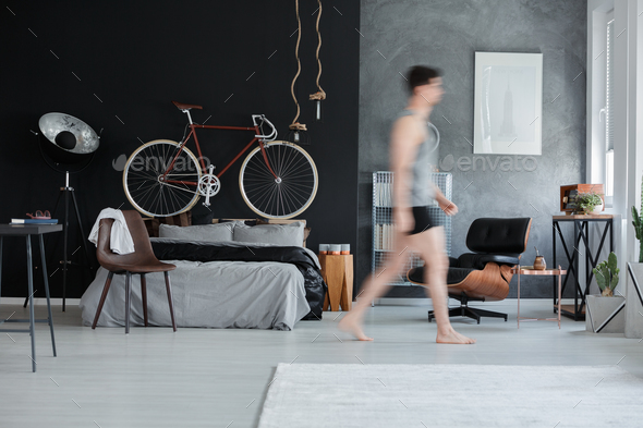 Bedroom with bicycle on wall - Stock Photo - Images