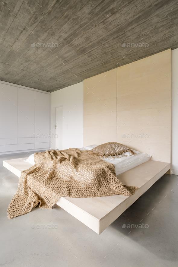 Bed on wooden platform - Stock Photo - Images