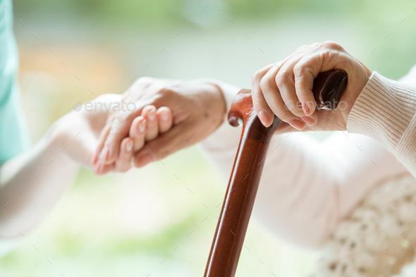 Elder person using walking cane - Stock Photo - Images