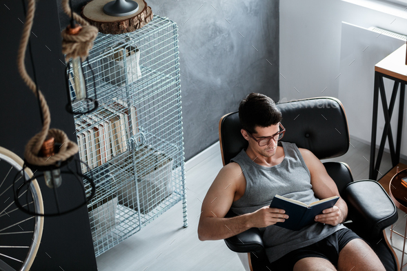 Young man reading book - Stock Photo - Images