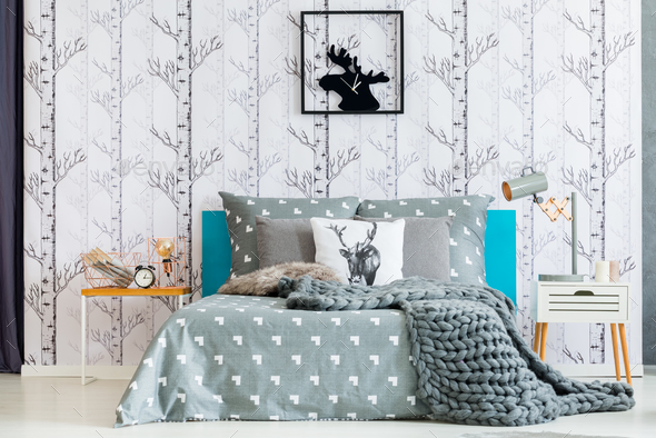 Moose clock in white bedroom - Stock Photo - Images