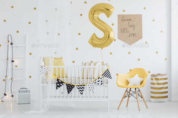 Pennants hanging on crib - Stock Photo - Images