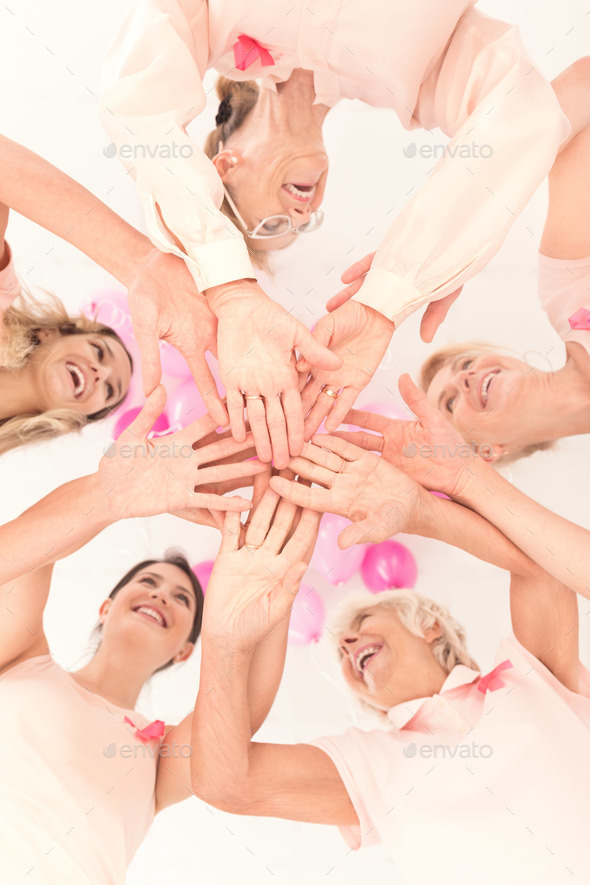 Joining hands, breast cancer support - Stock Photo - Images