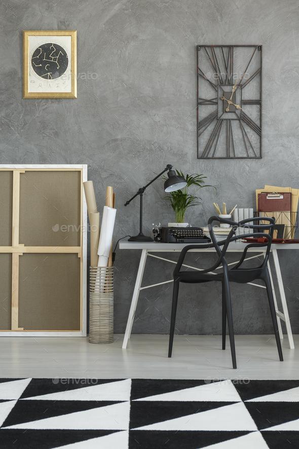 Geometric carpet in dark workspace - Stock Photo - Images
