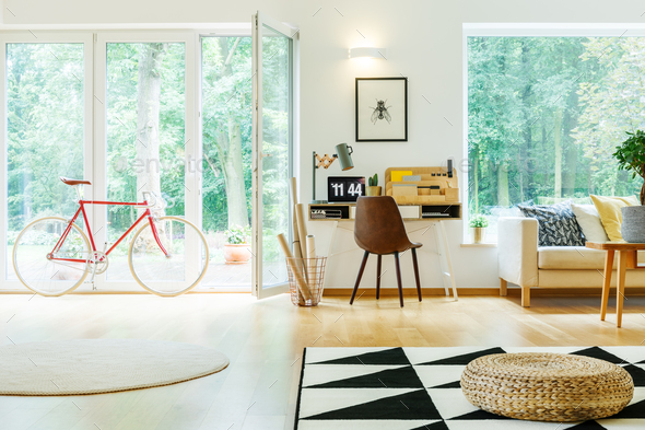 Spacious living room with pouf - Stock Photo - Images