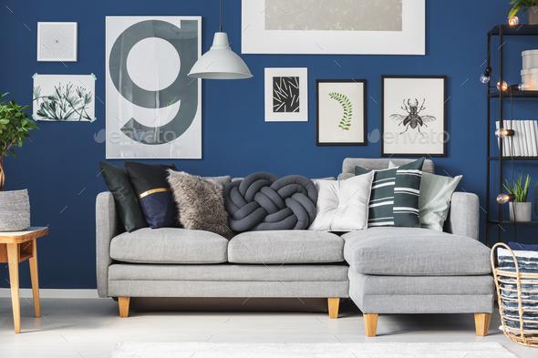 Pillows on grey corner sofa