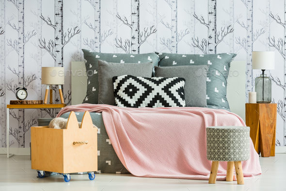Decorative pillow in feminine bedroom - Stock Photo - Images