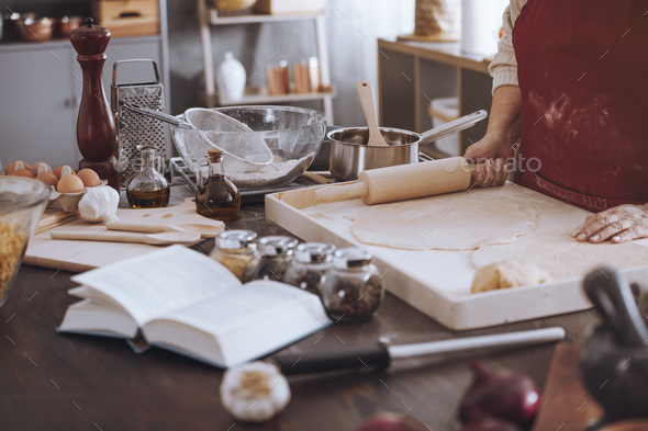 Cookbook and bowls on countertop - Stock Photo - Images