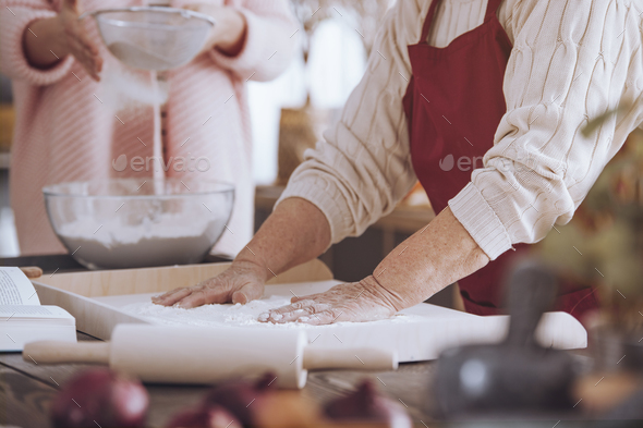 Close-up of person making cake - Stock Photo - Images