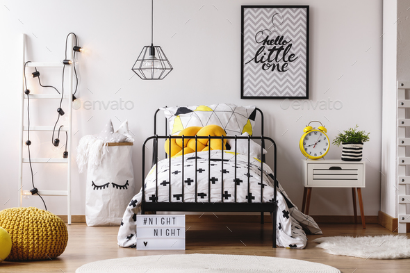 Yellow clock in child's bedroom - Stock Photo - Images